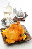 Baked chicken with lemon and orange — Stock Photo