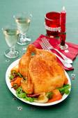 Baked chicken with pepper on green tablecloth — Stock Photo