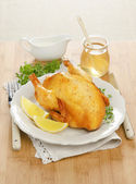 Baked chicken with lemon and honey — Stock Photo