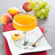 Fruit jelly with peaches and grapes — Stock Photo #56217113