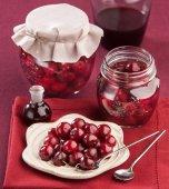 Cherry in juice in the pot — Stock Photo