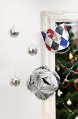 Christmas decorations ball mask and origami — Stock Photo