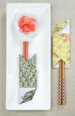 Caja de papel de origami sushi varas — Foto de Stock