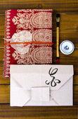 Envelope origami flower with hieroglyph — Stock Photo