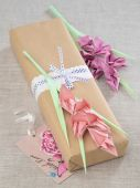 Origami paper flowers with gift box — Stock Photo