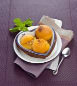 Apricot baked with almonds — Stock Photo