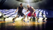 Basketball players  in gym — Stock Photo