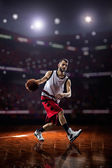 Red Basketball player in action — Stock Photo