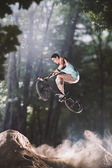Bmx bike rider in the forest — Stock Photo