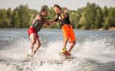 Two wake bord riders having fun — Stock Photo
