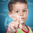 Little boy pressing high tech type of modern buttons on a virtua — Stock Photo #53090819