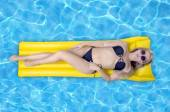 Woman relaxing in a pool — Stock Photo
