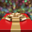 Decorative red gift box against a background bokeh — Stock Photo #59371641