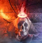 Skull with cloth and fire. — Stock Photo