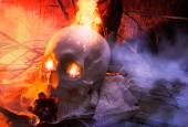 Skull with cloth and fire angle view. — Stock Photo