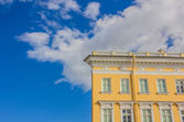 Part of historic building over blue sky — Stockfoto