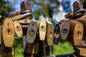 Close up locks at bridge in park — Stock Photo