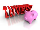Piggy coin bank with red INVEST word — Stock Photo