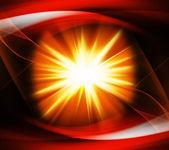 Uma intensa explosão de luz contra um fundo laranja — Fotografia Stock
