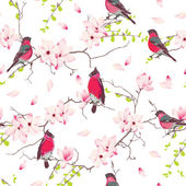 Red bullfinches on magnolia tree vector seamless print — Stock Vector
