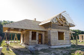 Construction of houses made of wood and brick — Stock Photo