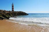 Lighthouse on the beach in Faro, Portugal — Stock Photo