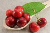 Abstract view cherry in a wooden spoon — Stock Photo