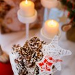 Cones and candles in the New Year composition — Stock Photo #60835503