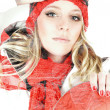 Attractive blonde female snowboarder wearing red and white snowboarding outfit is posing with goggles and a snowboard. — Stock Photo #59685195
