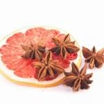 Star anis on a blood grape fuit slice — Stock Photo #66073775
