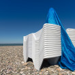 Sun lounger on a pebblestone beach — Stock Photo #56987545