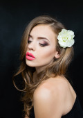 Portrait of a girl with red lips flower head — Stock Photo