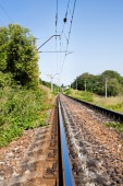 Prospect of railway in a landscape in summer — Stock Photo
