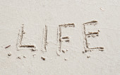 Inscription on the sand life — Stock Photo
