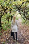 Beautiful girl in autumn forest — Stok fotoğraf