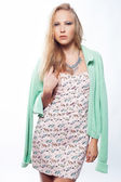 Young girl wear dress and green cardigan — Stock Photo