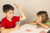 Kids playing cards — Stock Photo