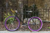 Bicycle tied to a fence — Stock Photo