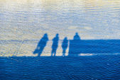 Family reflected in a river — Foto Stock
