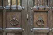 Old barred door — Stock Photo