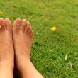 Foot on the green grass in the lawn. — Stock Photo #73080157