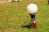 Lantern in the park and green grass — Stock Photo
