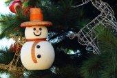 Snow man hanging on the Christmas tree. — Stock Photo