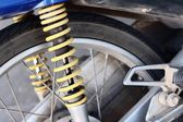 Shock absorbers of yellow motorcycles at the park — Stock Photo