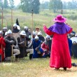 Samara, Russia, the festival of historical reconstruction ancient Russia ages 11-13 - August 16, 2013 - : a man in a dress of the 13th century Catholic priest blesses soldiers — Stock Photo #75794467