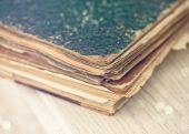 Old books of the Old binder on a white wooden surface — Stock Photo