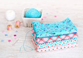 Fabric Pile of colorful folded textile with sew items — Stock Photo