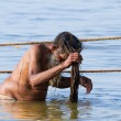 Hindu sadhu bathing at the Kumbha Mela, India. — Stock Photo #64674625