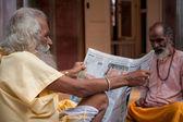 Sadhu reading paper — Stock Photo
