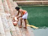 Temple Priest Washing Pots — Stock Photo